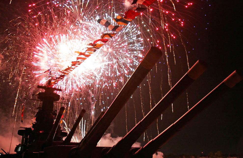 Fireworks-illuminate-the-skies-over-Battleship-North-Carolina-newest-Virginia-class-nuclear-attack-submarine-USS-North-Carolina
