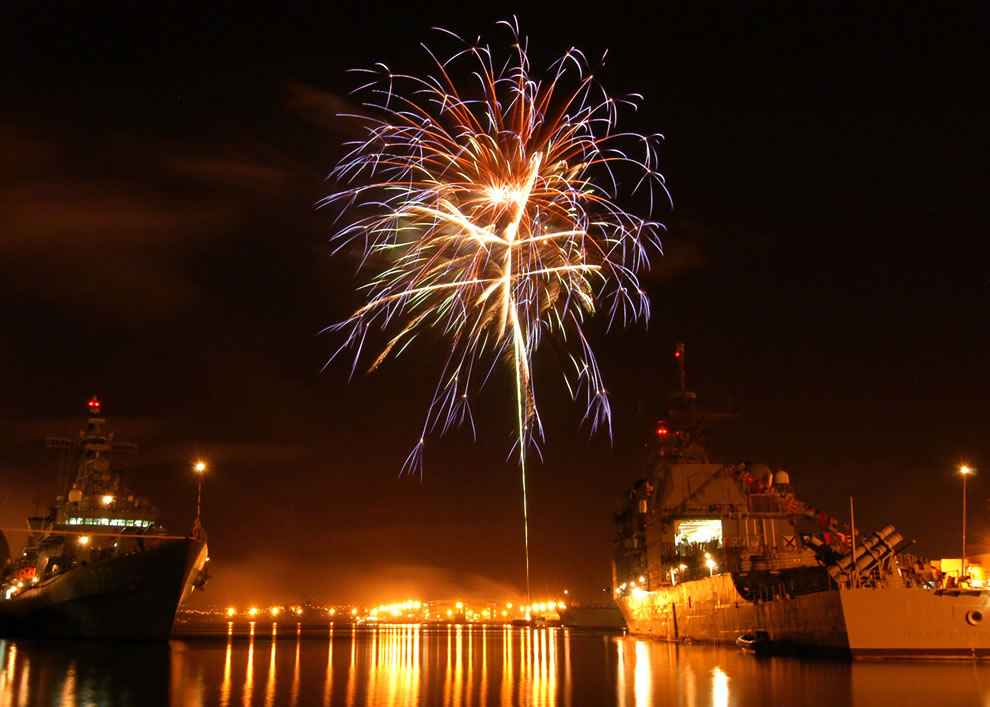 Fireworks-explode-over-the-guided-missile-cruiser-USS-Champlain-and-Republic-of-South-Korean-destroyers-Yi-and-Ulchimoonduk