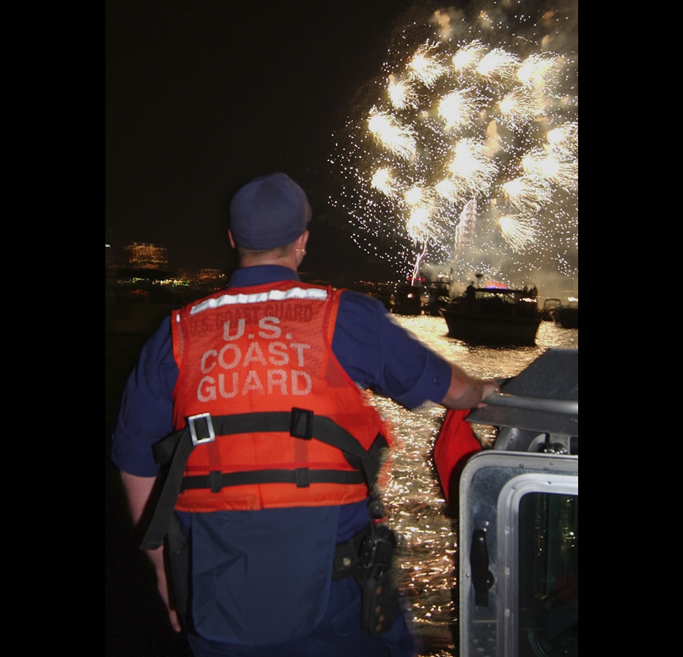 member-of-Coast-Guard-Station-Bostons-Harbor-Defense-Team-maintains-a-sharp-lookout-during-the-Fourth-of-July-fireworks-to-celebrate-our-nations-independence-and-freedom