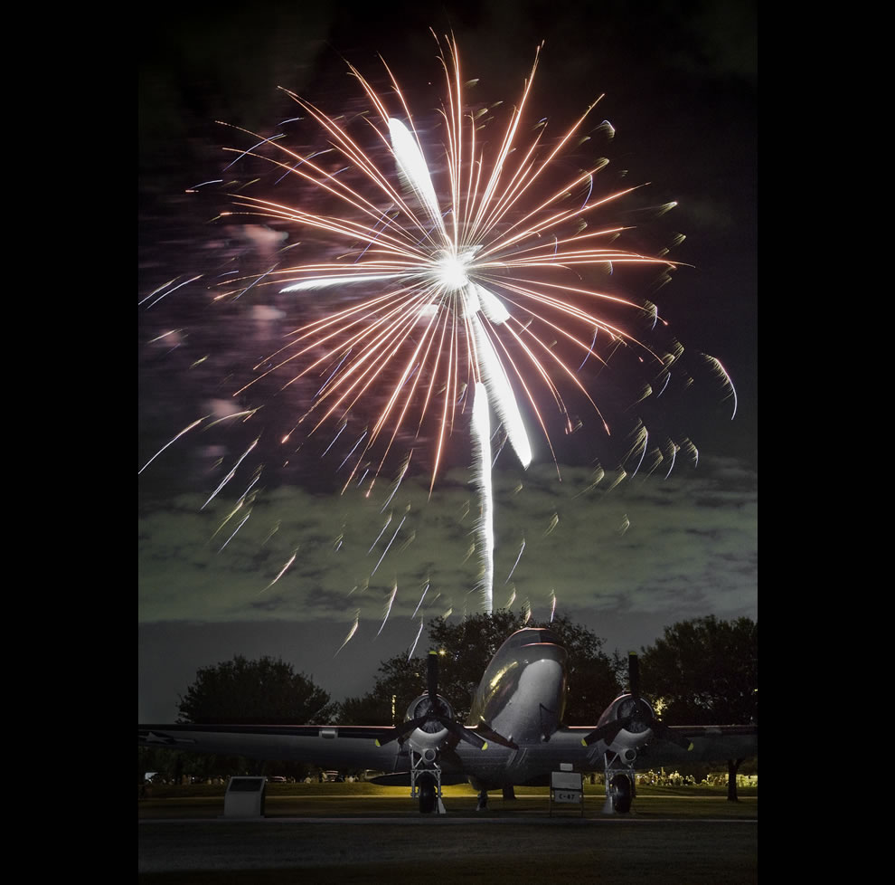A-C-47-cargo-aircraft-highlights-the-foreground-during-a-Fourth-of-July-fireworks-display